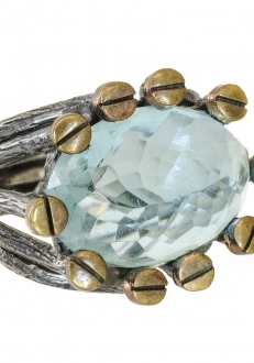 Blue Topaz Ring Circled with Gold Screws on Silver Band